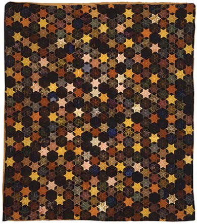 A hand-pieced velvet star mosaic quilt made by Annie Millar and found at the Ulster Folk and Transport Museum in Ireland, circa 1890